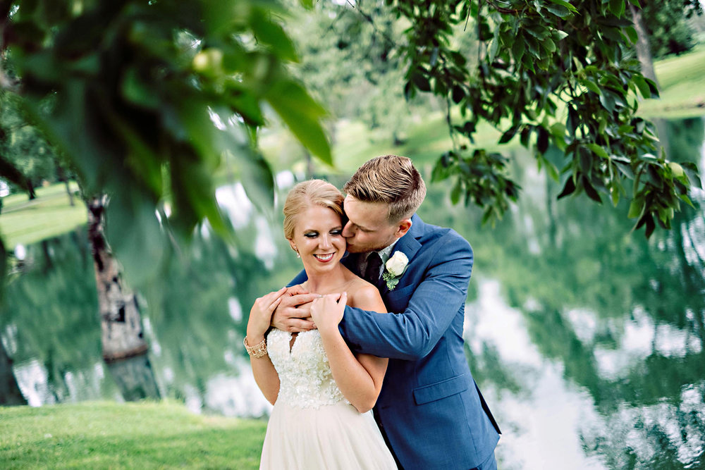 Bride and Groom cuddle in the country