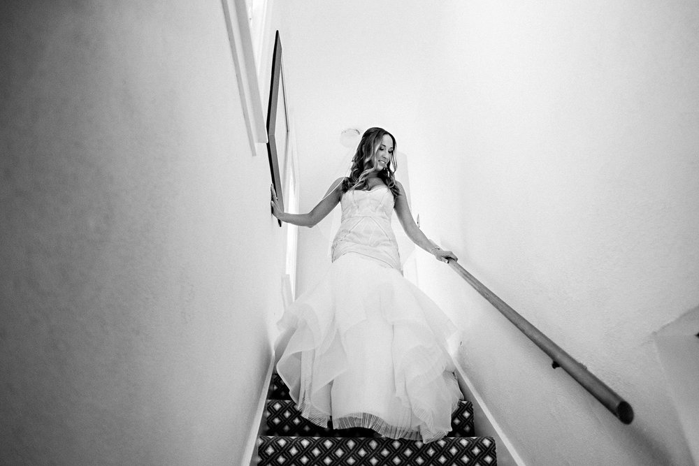 A bride walks down her stairs