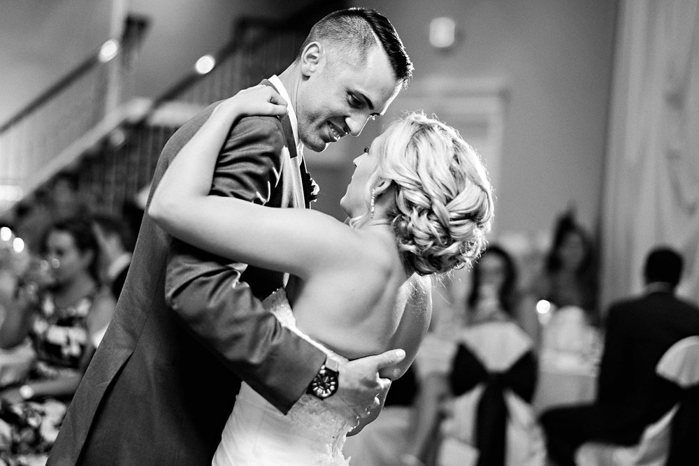 A bride and groom share their first dance