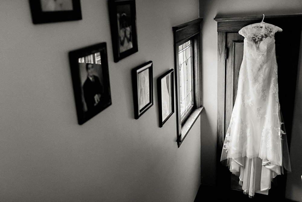 A wedding dress in window light