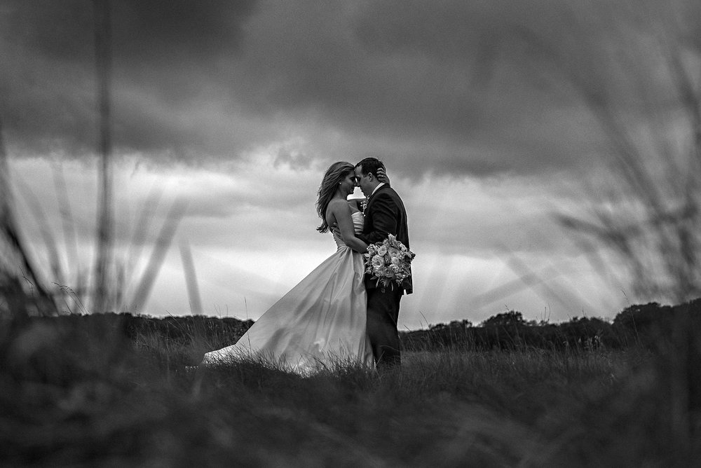 Bride and groom portrait during stormy weather