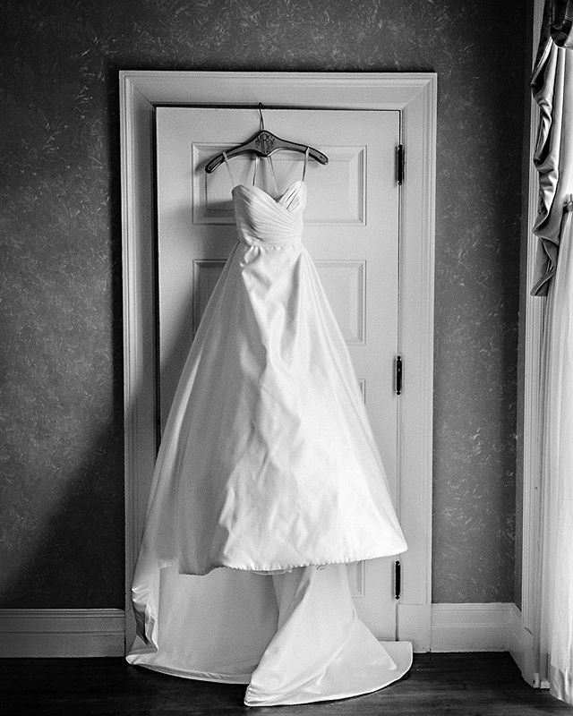 #weddingtips If you have always wanted a beautiful photo of your wedding dress hanging in anticipation of your wedding day, you should definitely think about this shot in the planning stages. A beautiful location to hang your dress with a large window nearby is always ideal. I never have been a huge fan of hanging a #weddingdress directly in the window because it usually takes away from the intricate details of your dress and in some cases the material underneath the dress shows through.  I always love when there is a large window adjacent to where the dress is hung as it makes for beautiful diffused light gives a soft look for your dress.  It's also a great idea to think about how your dress will be hung. Luckily for @emilybreitweiser's dress, @allertonpark has a beautiful suite with a large window next to a beautiful old door. Due to the textured wall, this has always been one of my favorite spots to get a classic, beautiful shot of a wedding dress. And don't forget a beautiful wooden hangar always looks great! . . . . . . #chicagoweddingphotographer #champaignwedding #champaignweddingphotographer #allertonpark #allertonparkweddings #springwedding #bride #groom #loveauthentic #makemoments #junebugweddings #portrait #ryantimmphotography #weddinginspiration #moments #love #togetherforever #instawedding #firstandlast #wedchicago #instaproofs ##coloradoweddingphotographer #californiaweddingphotographer #2020bride #theknot #marthastewartweddings #greenweddingshoes #weddingdetails