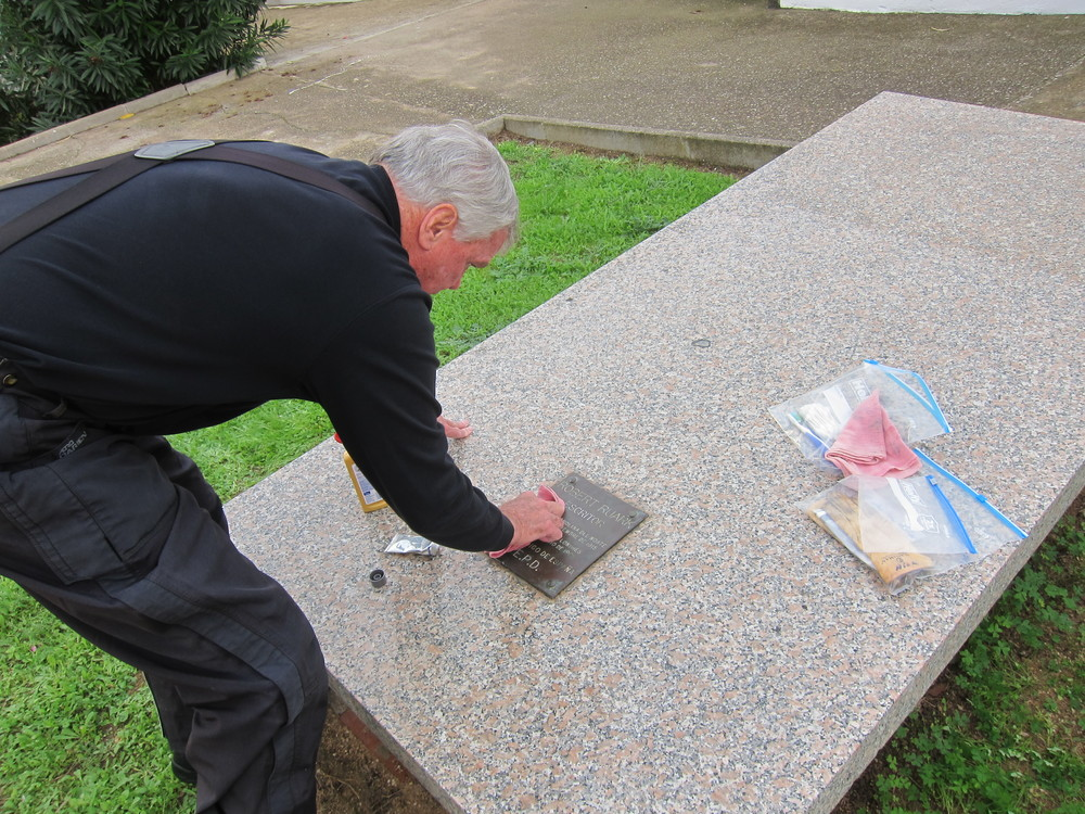 Nick Palmer performing upkeep on Ruark's grave