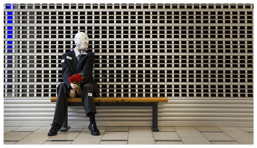 """""""Nobody should be lonely""""  -  Collaboration with Barbara Jazbec    Interactive work was placed in Chydenia-mall at Kokkola for four days with heart stickers on side - if you didn't want the man to be lonely, you could sit with him and give heart sticker to him."""