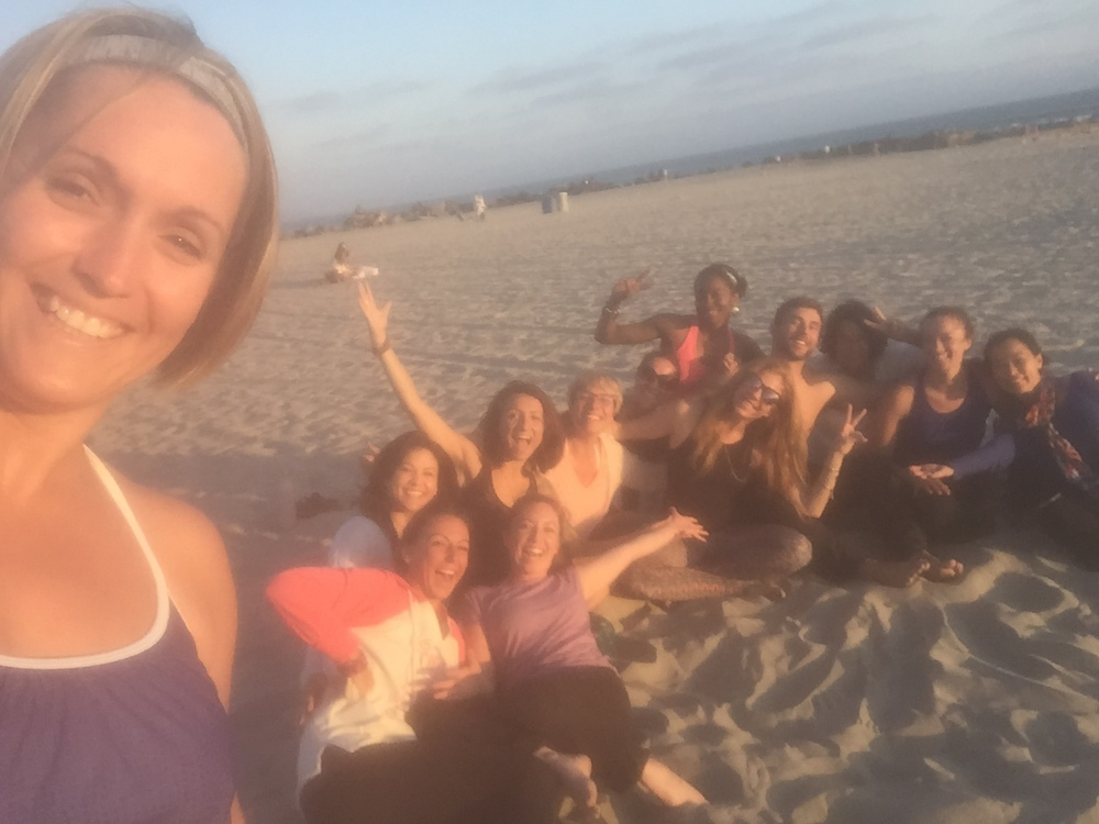 Break time for yoga on the beach with  Christi Cristensen  in San Diego!