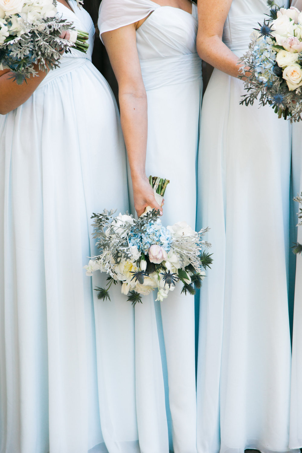 Gorgeous light blue bridesmaid dresses and wedding florals