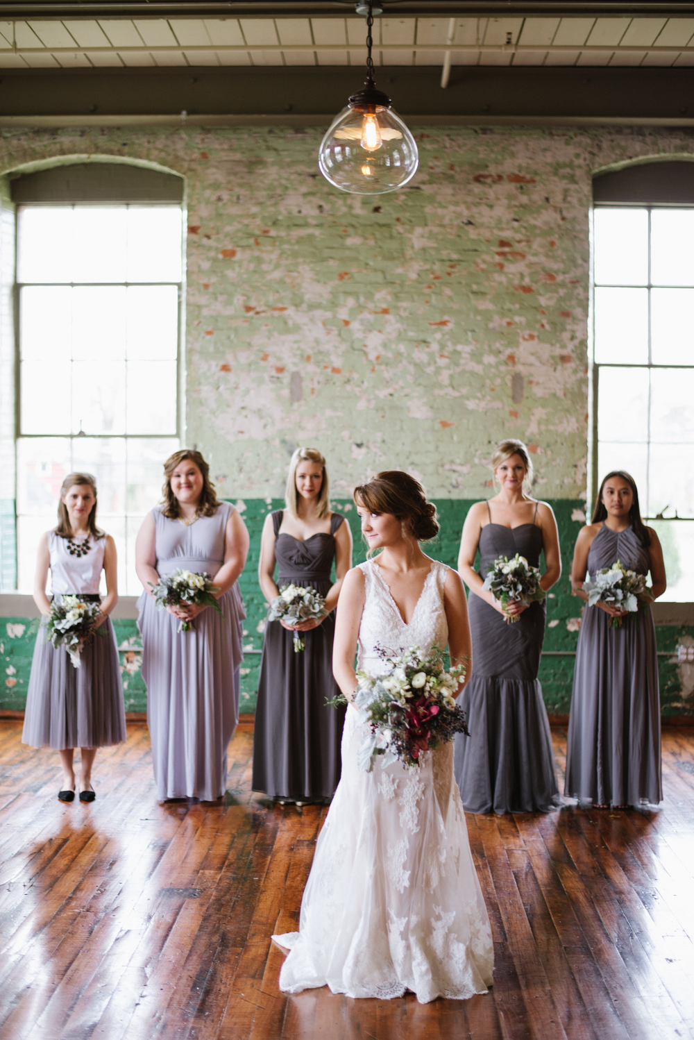 Mix and match bridesmaids dresses at an industrial-chic Georgia wedding.