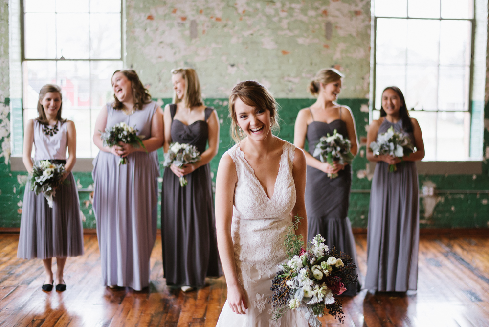 Mix and match gray bridesmaid dresses at an industrial-chic Georgia Wedding.