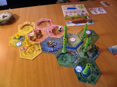 Takenoko - mid game showing three different land types and plenty of Green Bamboo growth