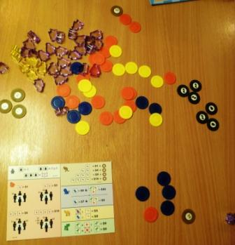 Crib sheet, coins and laser cut penguins in a Fistful of Penguins