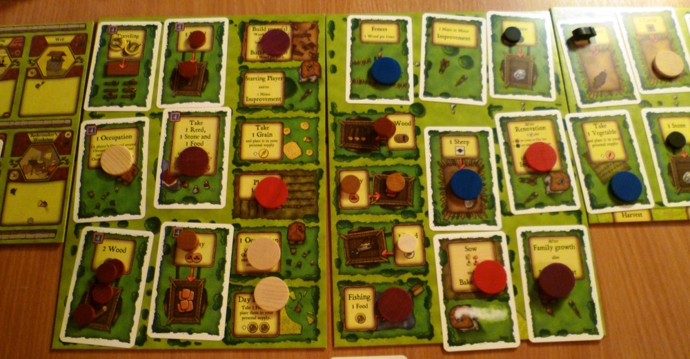 Agricola central board at games end with family members on them. some unused spaces still have materials on them