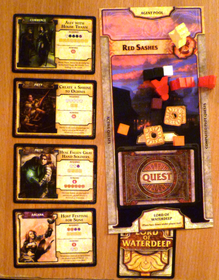 Player board with quests under way to the left, completed quests are placed face down on the player board