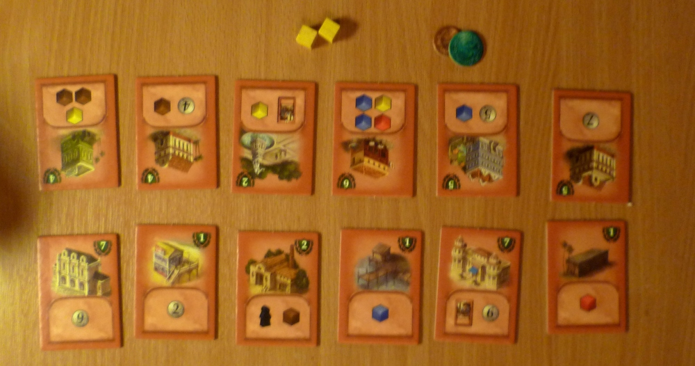 Victory point tiles with turns supply of cubes and money at the top