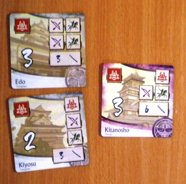 The victory point tiles, note the clan symbols in the bottom right hand corner, you can get bonus points for clan sets