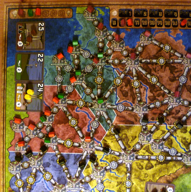 As this was a 3 player game only 3 areas are used, the black houses delinate the edge of the playing area.