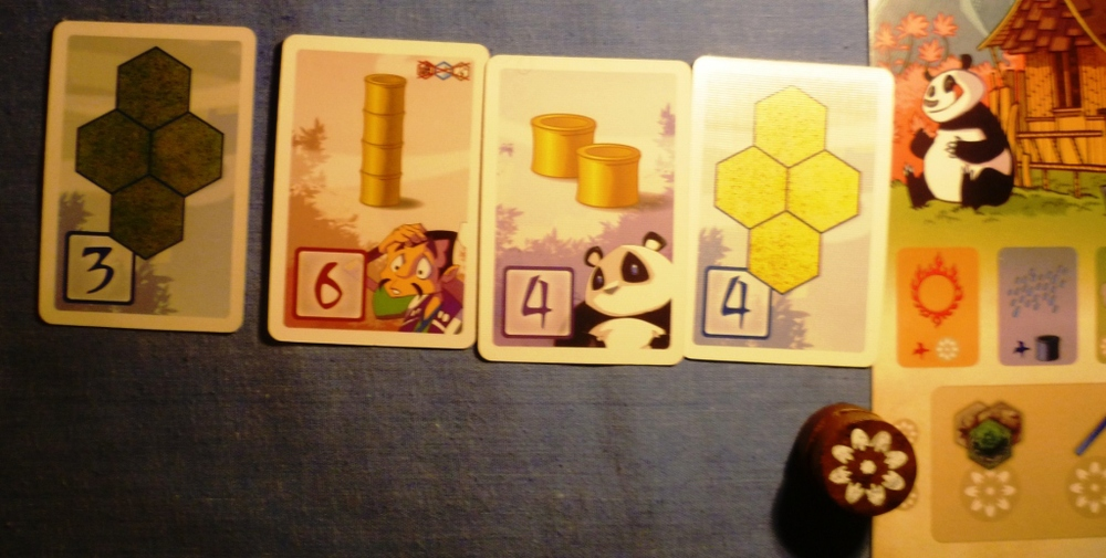 Mid game situation in the other game of Takenoko - You will notice more points cards than I had