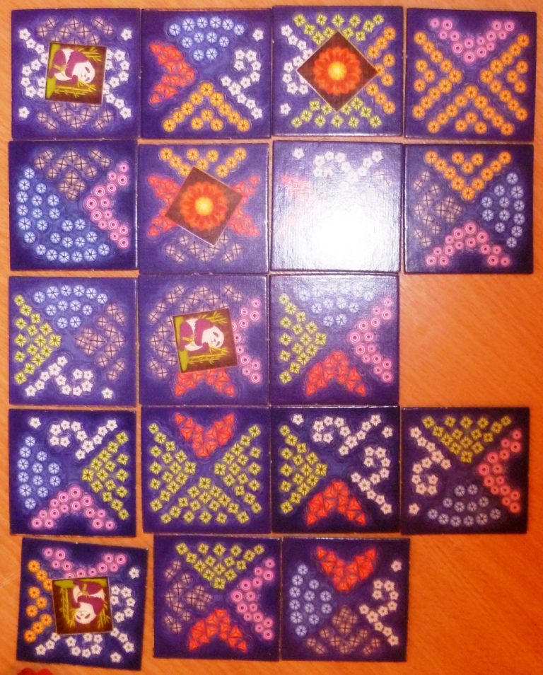 Lanterns part way through the game, match tile sides to collect resources