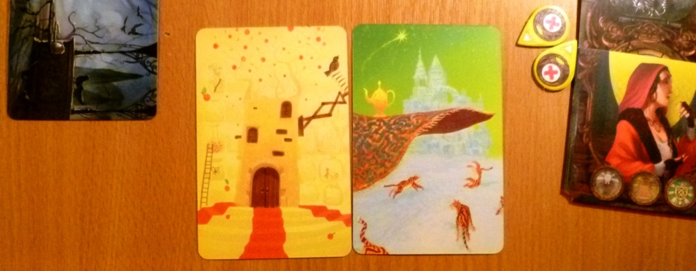 "Mysterium ""vision"" cards (quite ""dixit"" like in my opinion)."