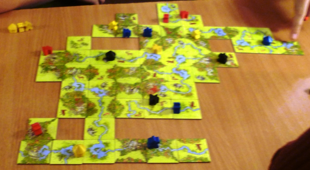 A rather blurry picture of the playing area showing rivers and forests