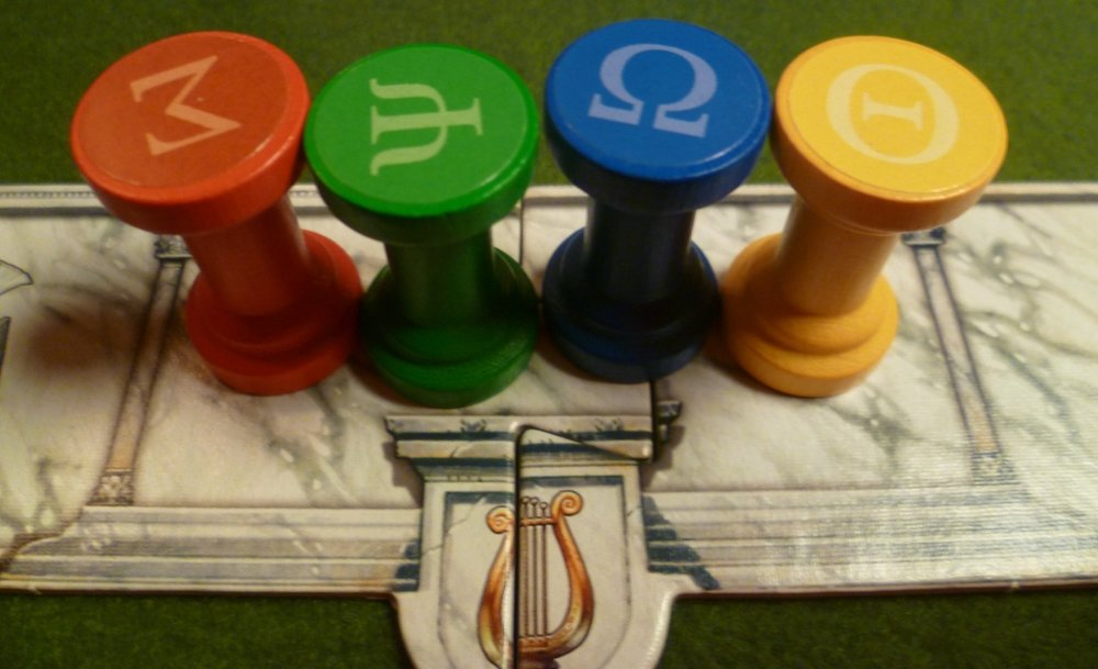 Each player starts each round with their four coloured totems