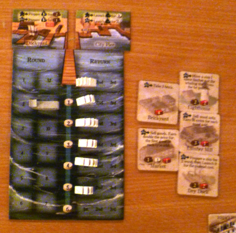 The whaling board showing we are on round 11, 6 ships at sea and to the right are 5 town tiles which can still be built.