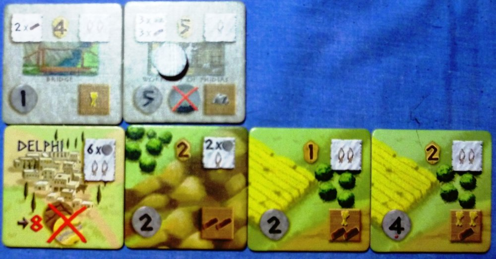 The top right town tile gave me immunity from plague (middle bottom symbol), it has a coin on it denoting I had not yet paid the 3 stone and 3 wood to build it. Note the common income symbols on adjacent land tiles.