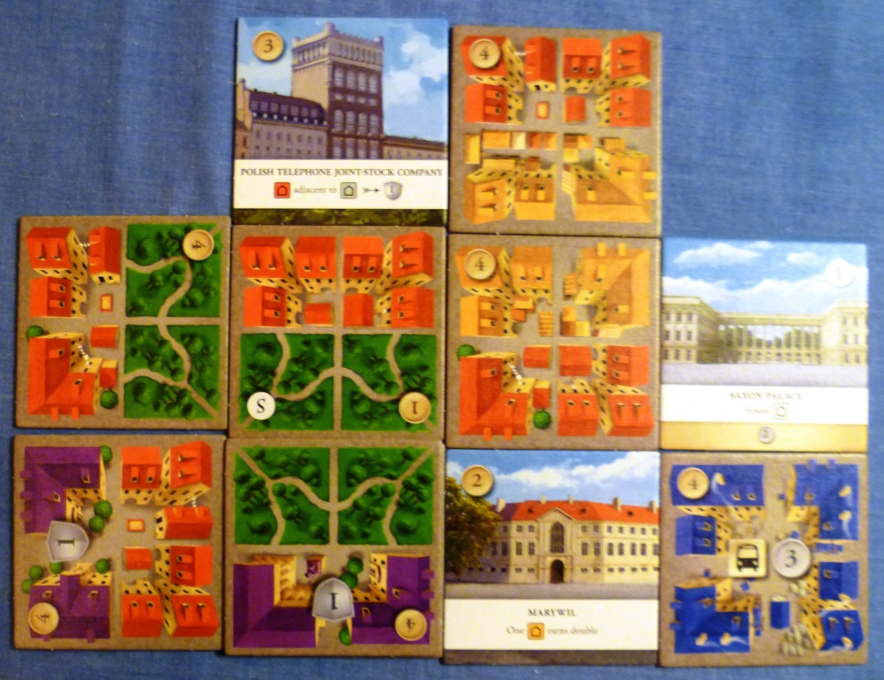 My layout during the game, my park has 4 separate residential areas scoring 5 points, my commercial area gets me 3 cash but my special tile at the bottom doubles this to 6 cash.