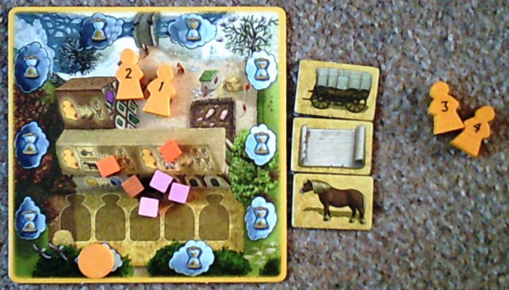 "A player board showing 1st and 2nd generation pawns, the ""time"" marker (currently at the bottom), some cubes and 3 artisan products."