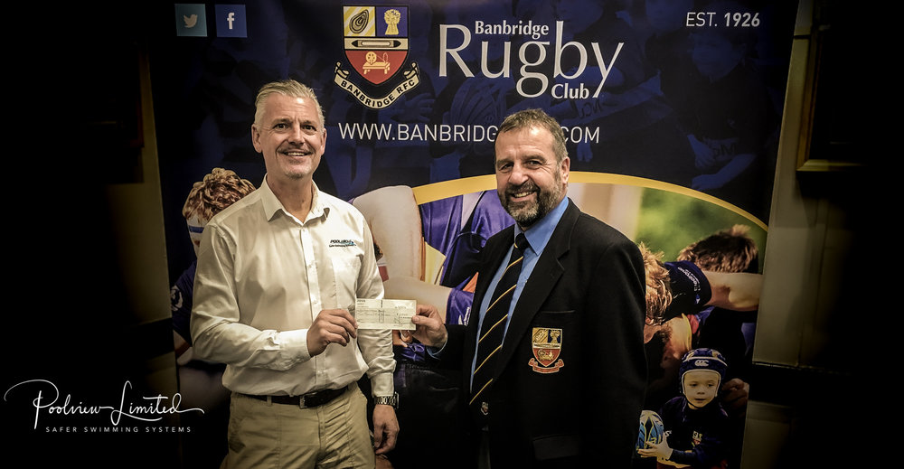 Poolview Director Robin McGloughlin with Banbridge RFC President Robbie Ervine