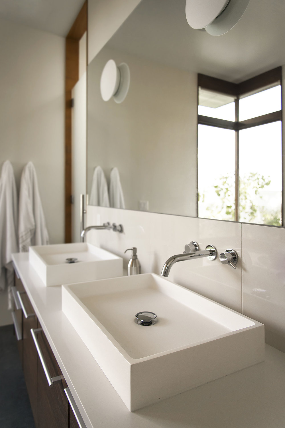 Rock Canyon  home - modern bathroom vanity sporting rectangular white vessel sinks and chrome wall mount faucets
