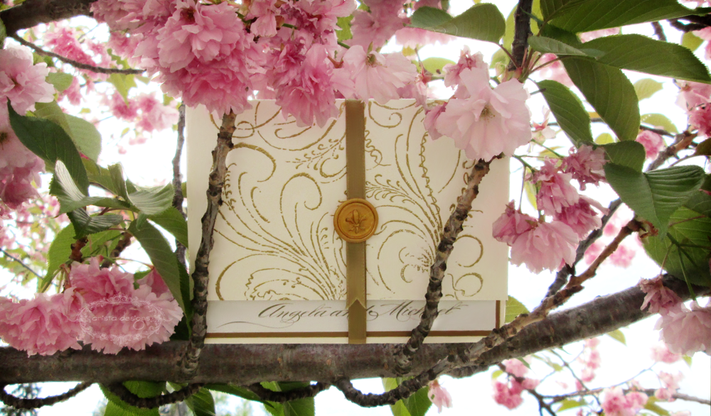 Our handmade  Angela collection  invitation perches high in a branch.