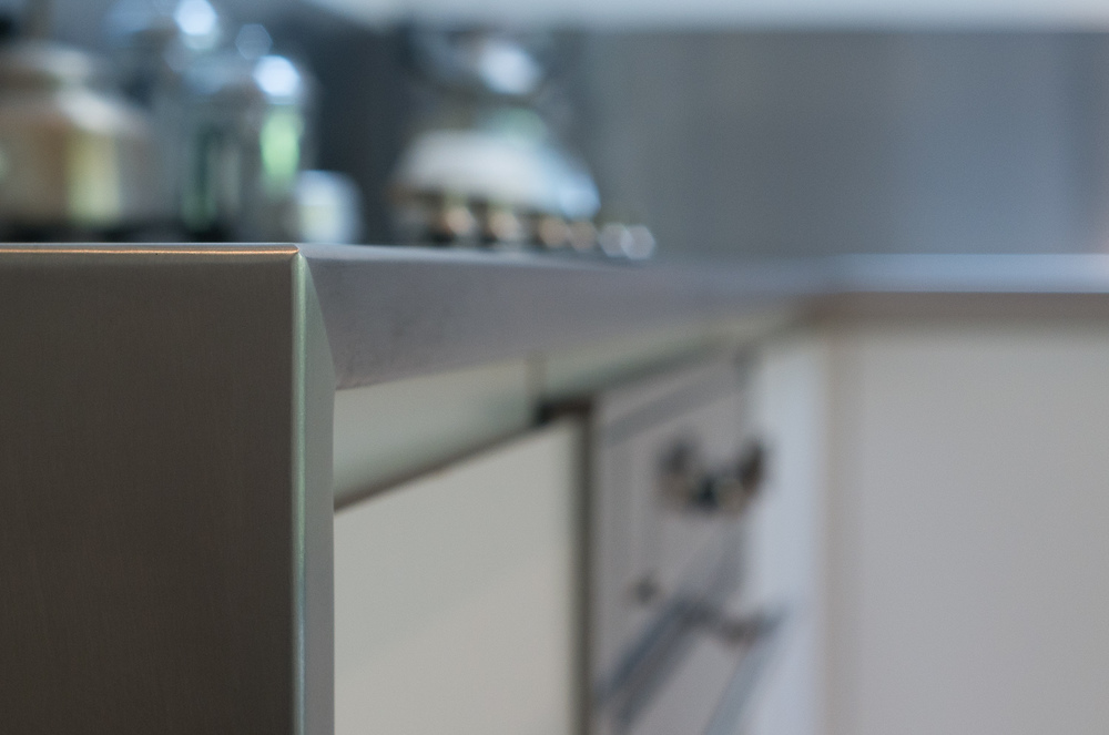 Bespoke design kitchen - mitred stainless work surface detail