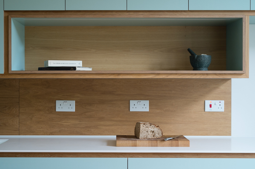 LG HiMacs work surfaces and spray lacquered oak veneered back splashes