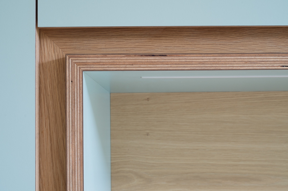 Detail showing mitred display shelf and oak trim
