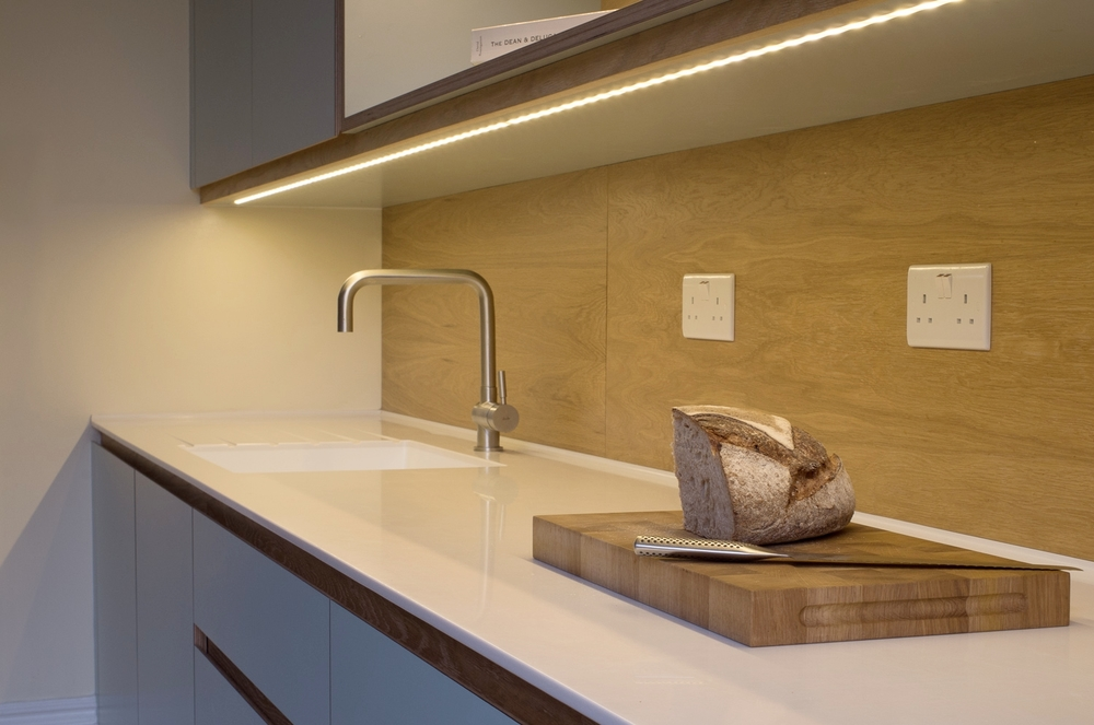 """Bespoke """"Crouch End"""" Kitchen cabinets with custom wood chopping board."""