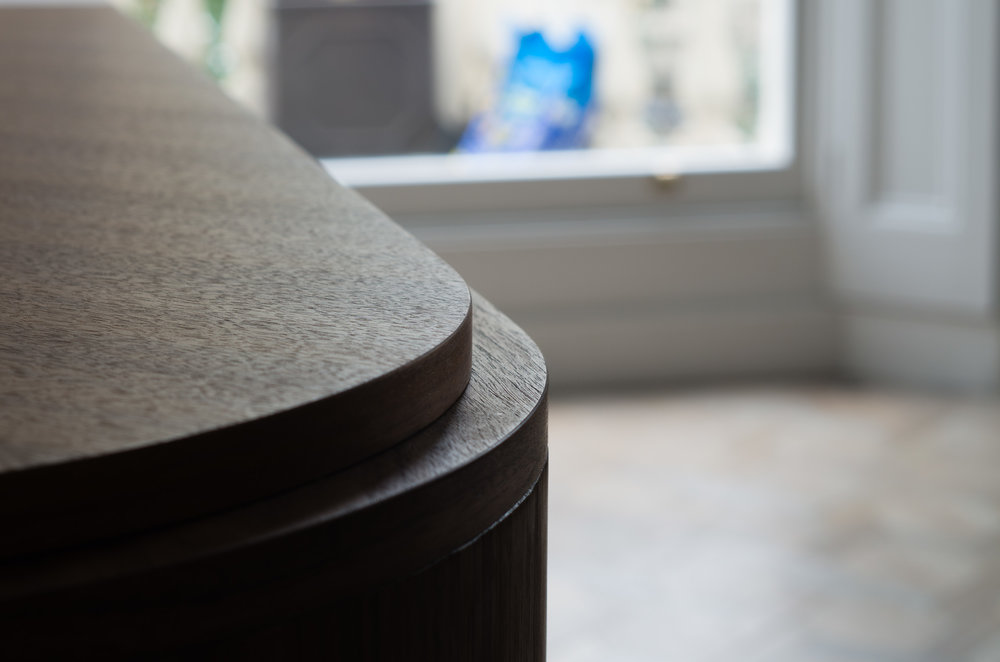 Bespoke freestanding furniture - detail of the curved ends of this custom veneered walnut sideboard