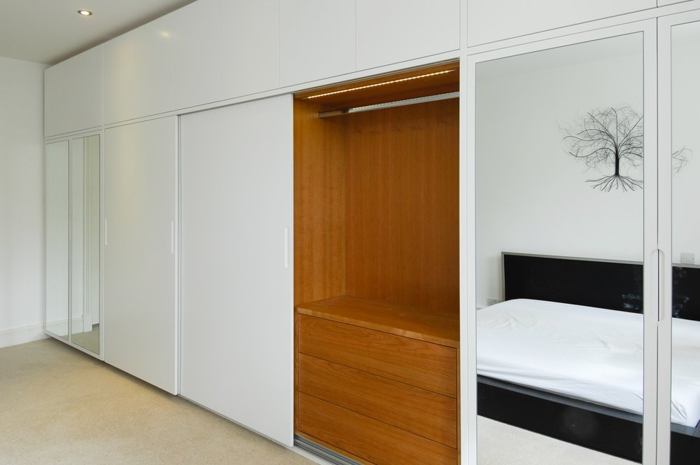 Copy of south kensington London bespoke fitted wardrobes with cherry interiors