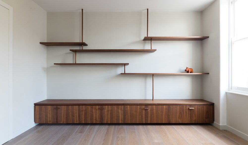 Japanese inspired shelving and bespoke fitted cabinets american black walnut