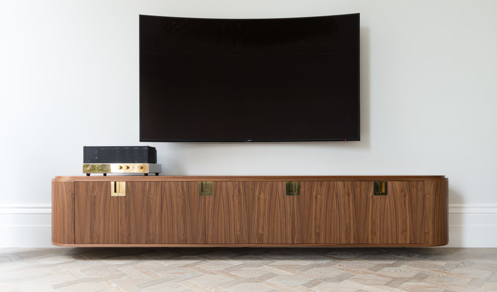 Custom freestanding furniture - Ballroom Media unit curved ends and walnut veneer