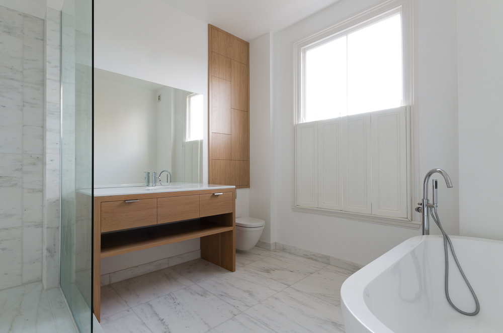 Side wide view of our bespoke fitted bathroom cabinet and unit.