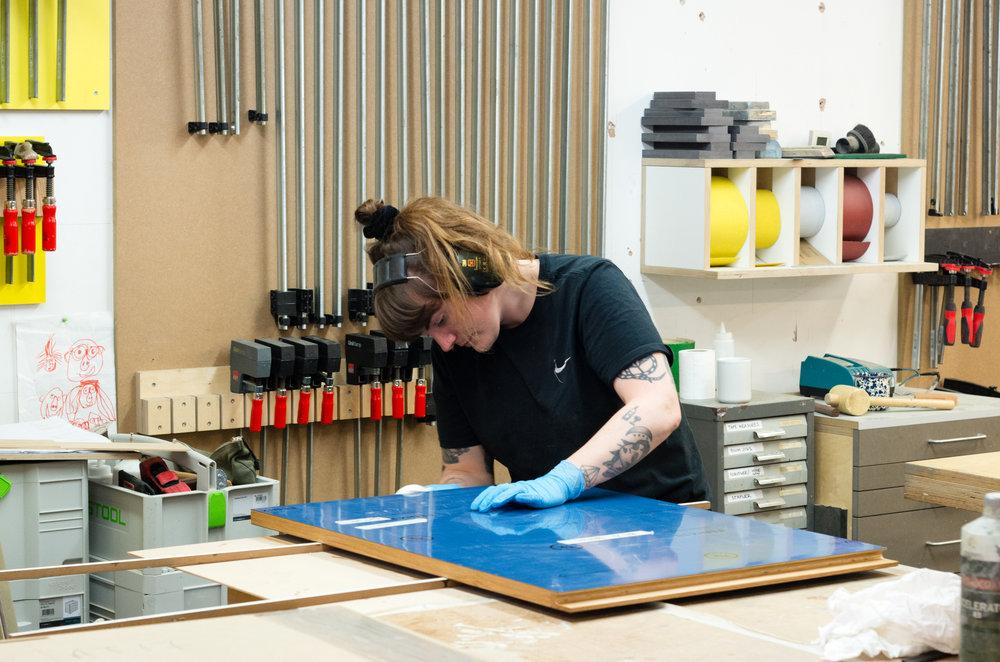 Our Intern Sara from Denmark finishing some kitchen doors. These have an mdf core with solid edging, and blue Fenix NTM laminate faces. Sara is studying furniture making in Copenhagen and is on a work placement with us for the summer.We try to have an intern working with us at all times. It's always good to have fresh design ideas and a different perspective on things.