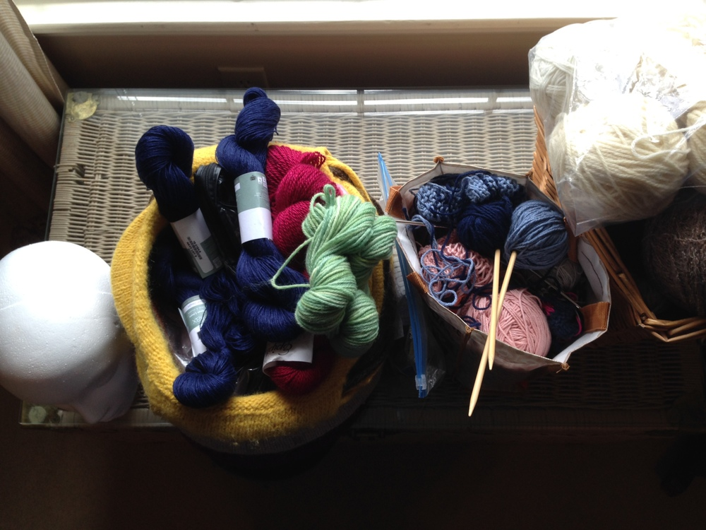 By the time I was through getting it all organized, I had one bag of yarn to put away, one bag of knitting projects to finish and a basket of odd-ball yarn to make decisions about. And a head, but that's a story for another day.