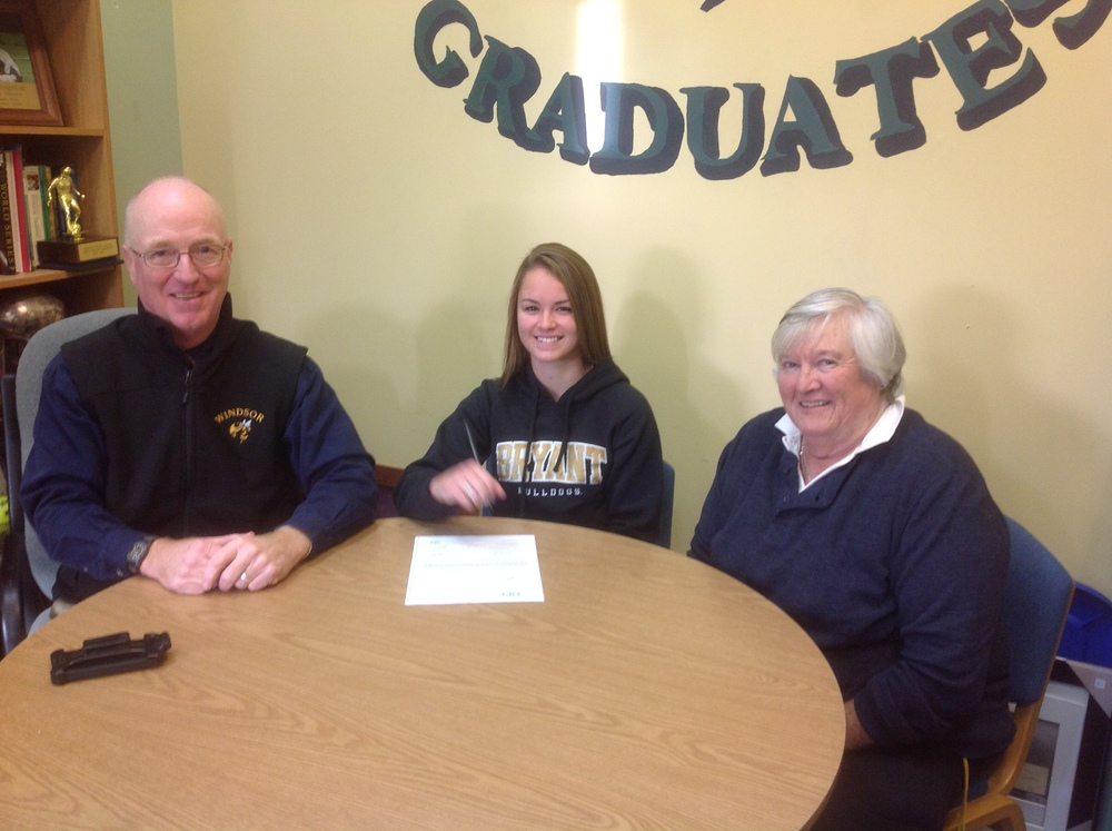 Haley Wood with Coach Sandy Clary and Athletic Director Bob Hingston signing her letter of intent to Bryant University in Smithfield, RI to play field hockey for the fall of 2015.