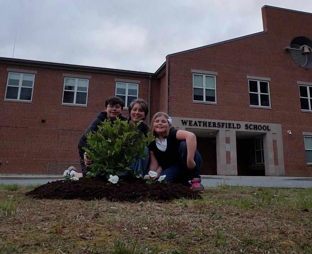 Kids planting Lilac Bush.jpg