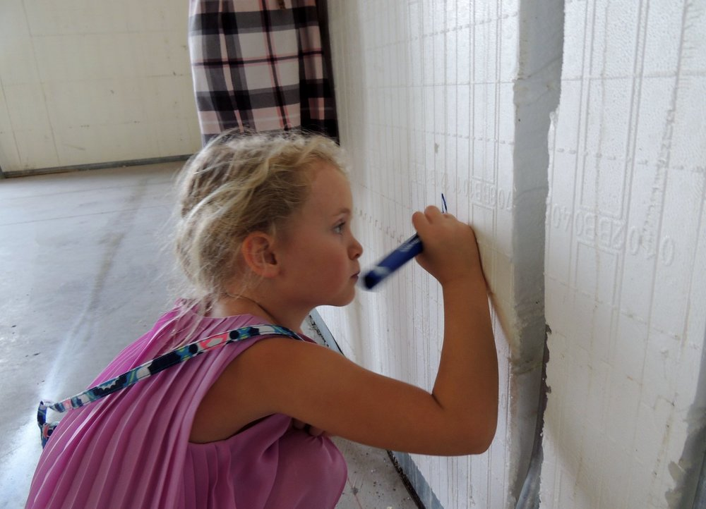 Cora writes on the wall.jpg