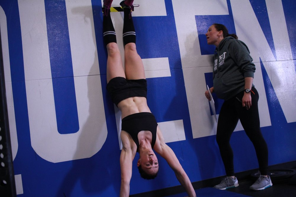 CrossFit movements with range of motion standards and scaling options.