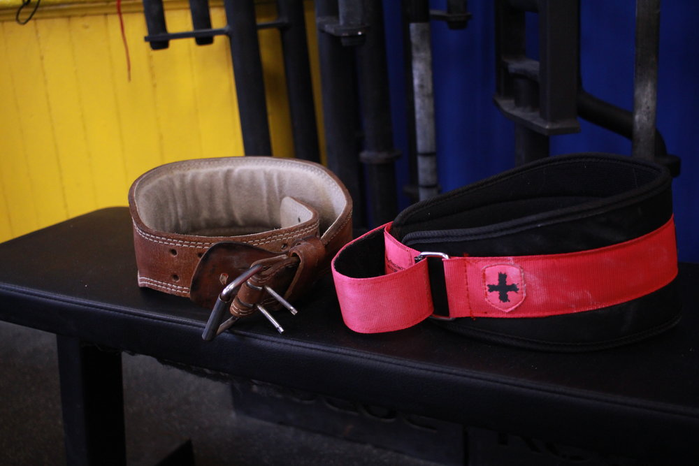 """Belts  Lifting belts come both in hard and soft variations, and at a number of widths. Athletes use belts to help them brace the abdominals during a heavy lift. This helps the athlete stabilize his or her spine. The jury is still out as to whether belts are """"good"""" or """"bad"""" for one's back, but many athletes find them useful for max lifts or heavy workouts."""