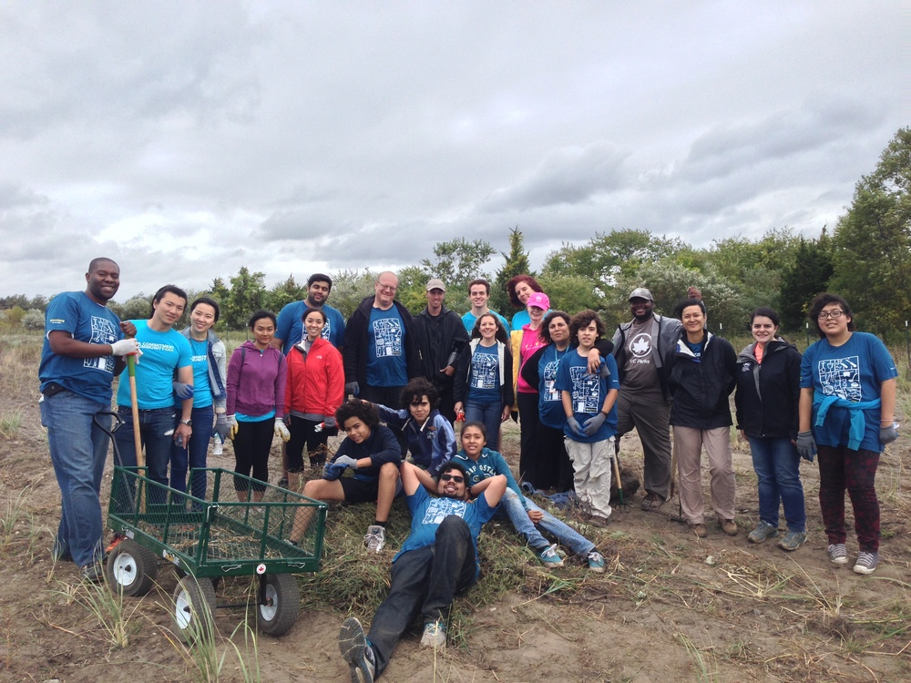 After a hard day's work of tending to an acre of the beach grass nursery at Floyd Bennett Field, volunteers smile for the camera.