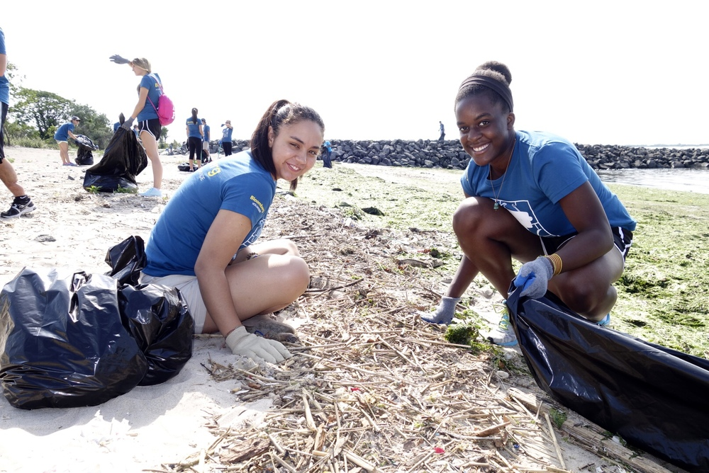 Volunteers remove debris from Plumb Beach.