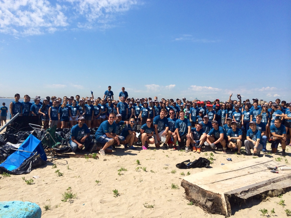 Two hundred interns remove litter and maritime debris bettering the beach for the community and wildlife that live at Plumb Beach.